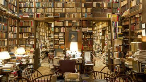 mansion library Piles-of-books-in-a-private-college-library_www.LuxuryWallpapers.net_