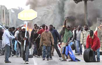migrants  rioting day