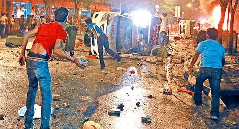 migrants rioting night